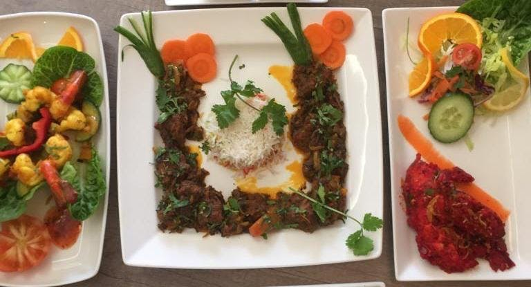Modhu Mitha Tandoori Restaurant Mansfield image 1